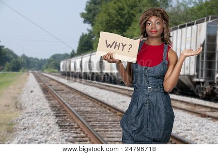 Woman Holding A Why Sign