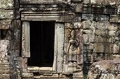 Ancient Stone Bas-relief Of Banteay Kdei Temple, Angkor Wat, Cambodia. Ancient Temple Door With Ston poster