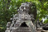 Ancient Stone Ruin Of Banteay Kdei Temple, Angkor Wat, Cambodia. Ancient Temple Tower With Face In F poster