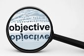 stock photo of objectives  - Close up of magnifying glass on Objective - JPG
