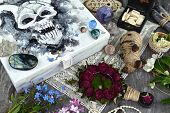 Box With Scary Demon Face, Magic Mirror, Voodoo Doll And Myctic Objects On Witch Table. Occult, Esot poster