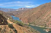 stock photo of apache  - Apache Trail winding along Apache Lake in Sonoran Desert - JPG