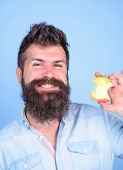 Eat Apple Every Day. Man Handsome Hipster Long Beard Eating Apple. Hipster Hungry Almost Eaten Apple poster