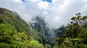 Scenic view of Trou de fer waterfall on Reunion Island National Park with cloudscape background and