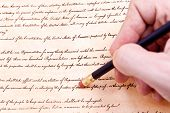 Closeup Of Hand Pencil Erasing First Amendment To U.s. Constitution
