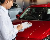 This Career Man Saleman Business Inspection Writing On Notepad Or Book, Paper With Car Blurry Backgr poster