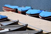 Old And Nostalgic Pedal Boats And Row Boats On A Pier, Row Boat And Pedal Boat Parked In A Line At T poster