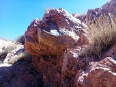 Geology Mountains Stones And Rock Formation Morocco Atlas Brown Stone Texture. Rock Formation With C poster