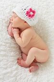 stock photo of sleeping baby  - Newborn baby girl asleep on a blanket - JPG