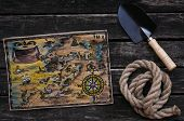Treasure Map, Shovel And Rope On Old Wooden Table Background. Treasure Hunter Concept. poster