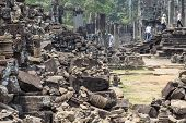 Ancient Stone Ruin In Angkor Wat Temple. Messy Stone Debris In Tourist Place. Khmer Heritage Temple  poster