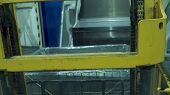 Forklift Truck Loading A Truck. Forklift Truck Driver Unloading Pallet In Storage Warehouse. Forklif poster