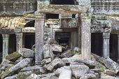 Ancient Stone Ruin In Angkor Wat Temple. Aged Demolished Building With Stone. Khmer Kingdom Heritage poster
