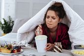 Lots Of Desserts. Heartbroken Woman Eating A Lot Of Desserts Because Of Depression And Huge Stress A poster