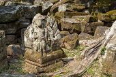 Hindu God Mossy Stone Statue. Angkor Wat Temple, Cambodia. Vishnu God Statue. Ancient Temple Ruin In poster