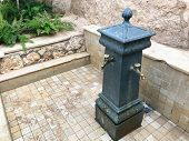 Black Iron Carved Forged Fountain With Three Beautiful Textured Faucets, Valves, Brass Fittings, Cop poster