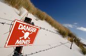 picture of landmines  - A signpost warning of the danger of landmines left on a beach during the Argentinian invasion of the Falkland Islands in 1982 - JPG