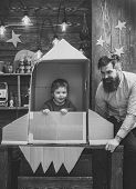 Childhood Dreams. Boy Play With Dad, Father, Little Cosmonaut Sit In Rocket Made Out Of Cardboard Bo poster