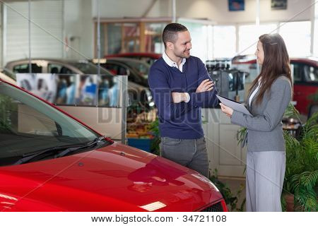 Man speaking to a businesswoman in a garage