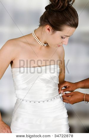 Woman in a wedding dress getting ready for the day