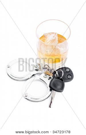 Car key next to a whiskey and a handcuff against a white background