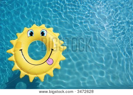 Sun Shape Float On A Swimming Pool