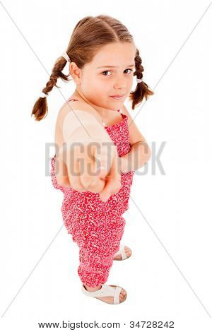Full length portrait of a happy little girl pointing on white background