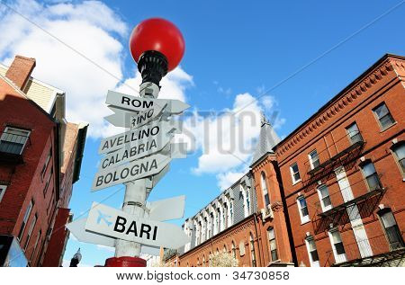 Sign depicting direction of different Italian Cities in the LIttle Italy section of the North End of Boston, Massachusetts, USA.