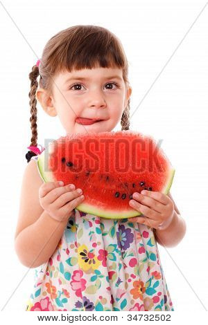 Litle girl eating a watermelon