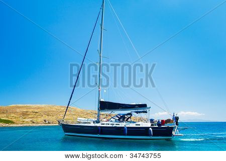 Sail Boat in Tropical Blue Ocean