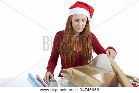 Young Woman Is Packing  Present For Christmas Isolated