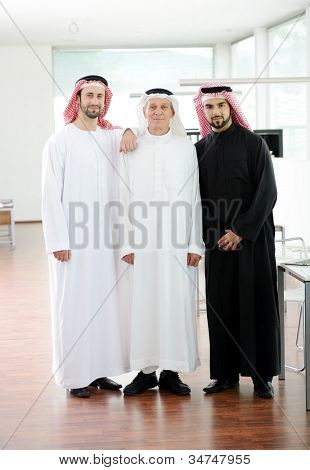 Happy smart business Arabic men standing in office at work