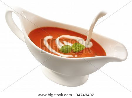 Sauce boat with creamy red sauce
