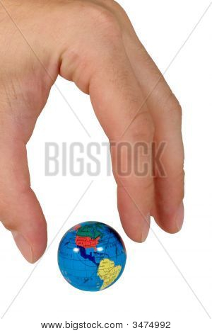 Human Fingers Ready To Seize A Small Globe
