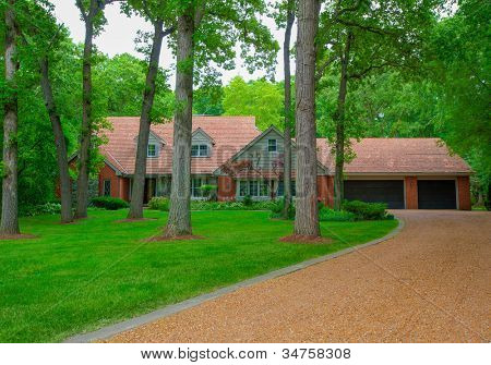 Traditional North American Residential House in Wooded Area in summer Season