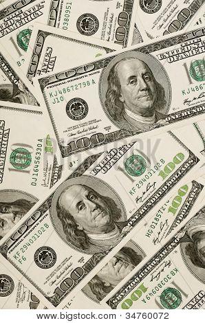 Fundo de dinheiro, a pilha de dólares, conceito financeiro dos ganhos