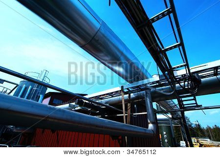 Industrial Zone, Installation Of Steel Pipelines And Cables In Blue Tones
