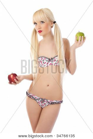 Sexy Blonde Woman In Lingerie Holding Apples