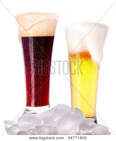 Frosty Glass Of Dark And Light Beer With Foam,ice And Water Drops Isolated