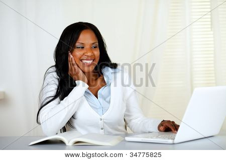 Lovely Student Woman Smiling And Looking To Laptop