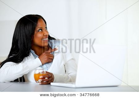 Afro-american Young Woman Pointing To Her Left