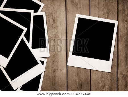 Instant Photos At Wooden Background