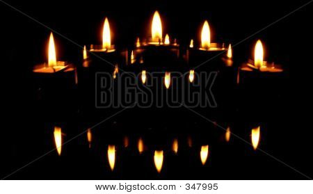 Five Candles And Their Reflections