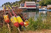 stock photo of lobster boat  - Lobster buoys and traps in a fishing village Maine - JPG