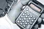 pic of workplace accident  - Injury claim concept with injured hand holding calculator - JPG