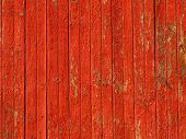 stock photo of red barn  - close up of red barn boards that have been weathered - JPG