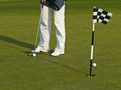 picture of foursome  - The Golf course with ball and flag - JPG