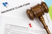 stock photo of workplace accident  - Directly above photograph of an insurance claim form - JPG