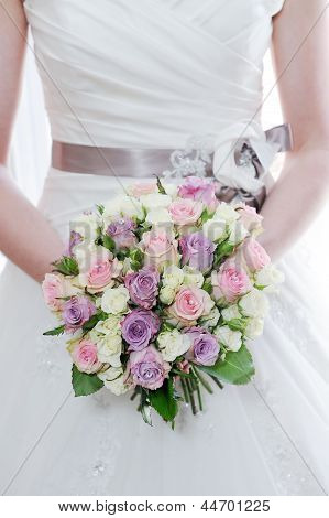 Brides Bouquet And Dress Closeup