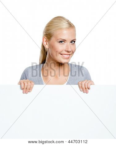 Woman keeping huge sheet of white paper, isolated on white, copyspace